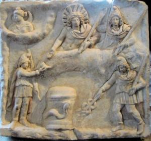 Roman artifact with Sol Invictus (top middle with sun crown) and Mithra (to his right) atop a bull