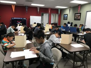 Students take the AMC 8 exam at Areteem Headquarters